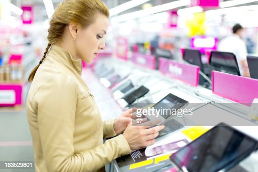 Woman buys a digital tablet.
