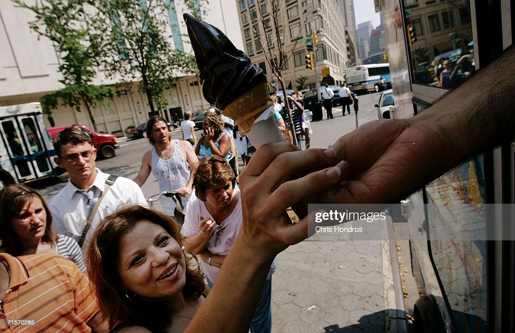 A woman buys an ice cream cone from a vendor as others wait in line on the Upper West Side August 2, 2006 in New York City. Forecasters have called for high temperatures of 100 degrees in the city with the heat wave continuing through tomorrow.