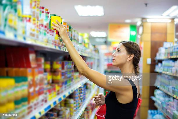 woman buys canned