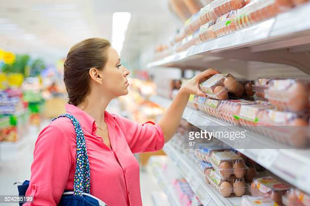 woman buys eggs