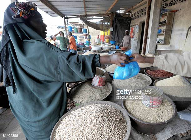 A woman buys on June 4 2008 cereal at the Abobo market in Abidjan on the second day of the the UN Food and Agriculture summit on food security in...