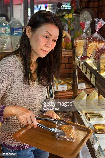 Woman buys pastry at a bakery