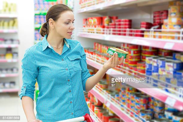 woman buys tinned meat