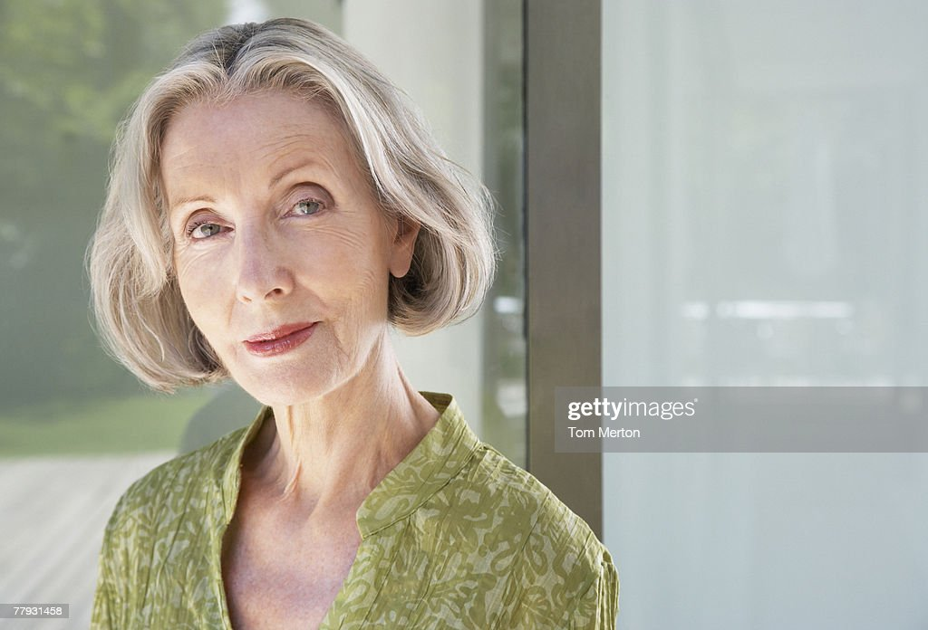 Woman by a large window : Stock Photo