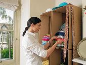 Woman by cardboard box wardrobe