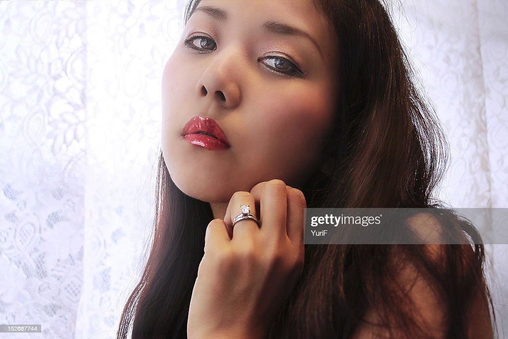 Woman by curtains : Stock Photo
