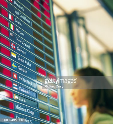 Woman by foreign exchange board
