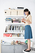 Woman by Shelves