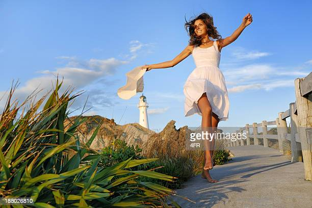 Woman by the Lighthouse, New Zealand