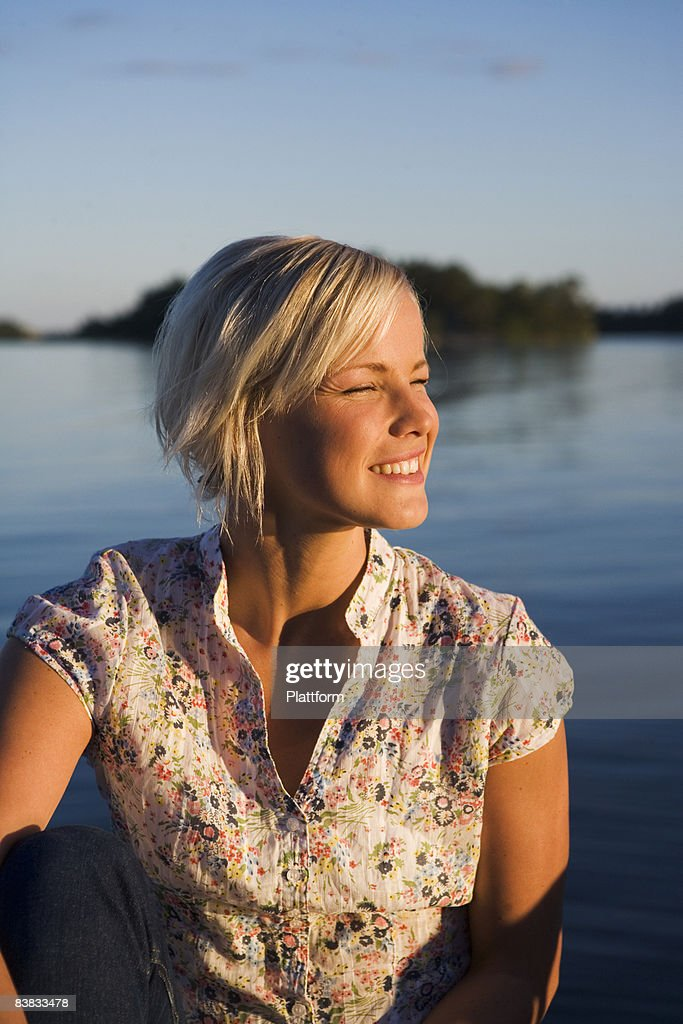A woman by the sea in the archipelago of Stockholm Sweden. : Stock Photo