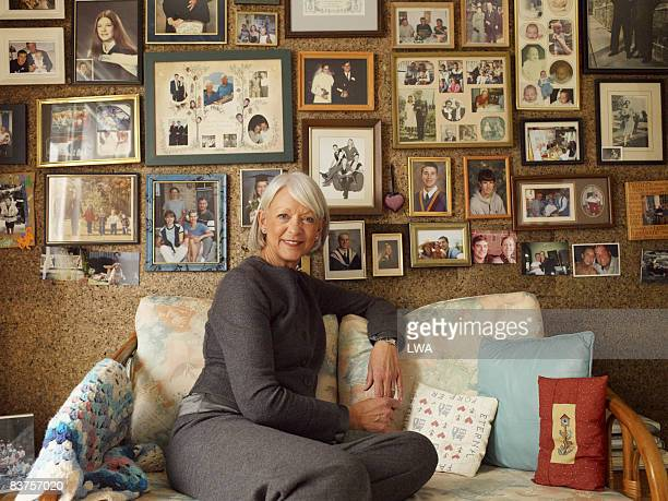 Woman By Wall of Family Pictures