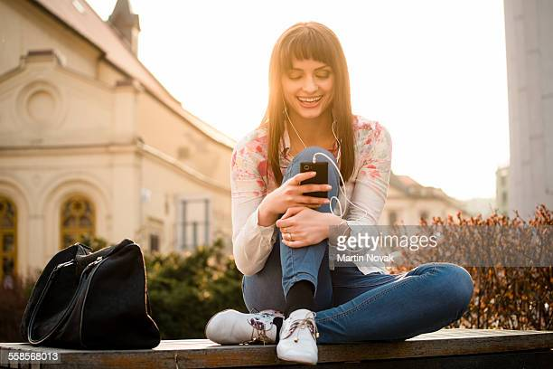 Woman calling phone in street