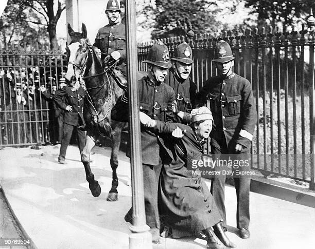 A woman campaigning for the vote is restrained by policemen British women did not win full voting rights until 1928