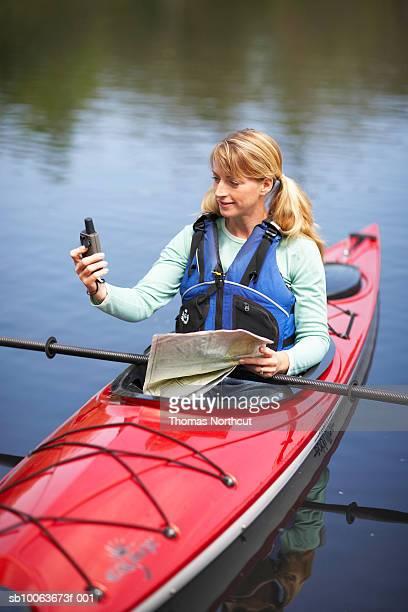 Woman canoeing on lake, Seattle, Washington, USA
