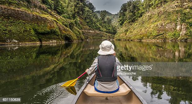 Woman canoeing on river Whanganui, North Island, New Zealand