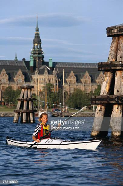 Woman canoeing Stockholm Sweden.