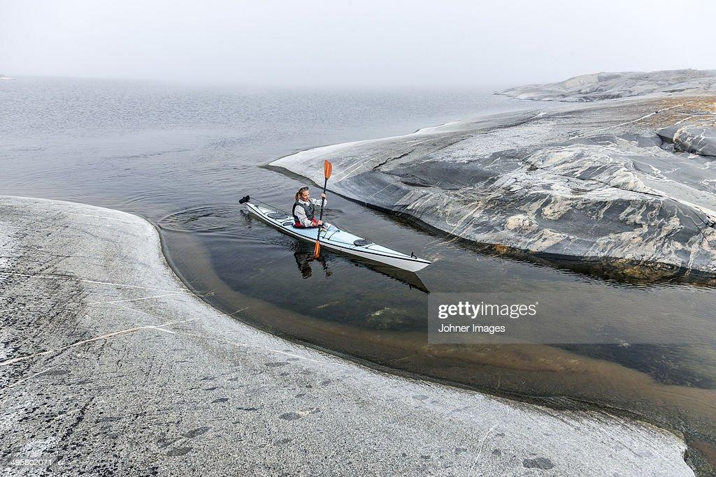 Woman canoeing, Sweden