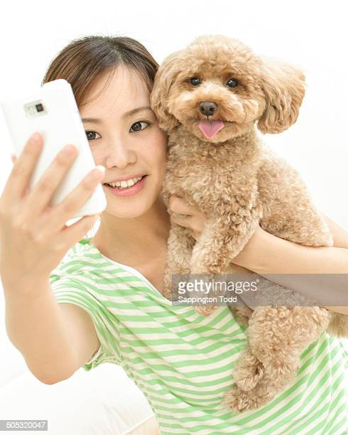 Woman Capturing Photo With Pet Dog