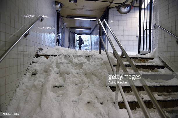A woman carefully enters Columbia Circle subway stop on January 23 2016 in New York City A major Nor'easter is hitting much of the East Coast and...