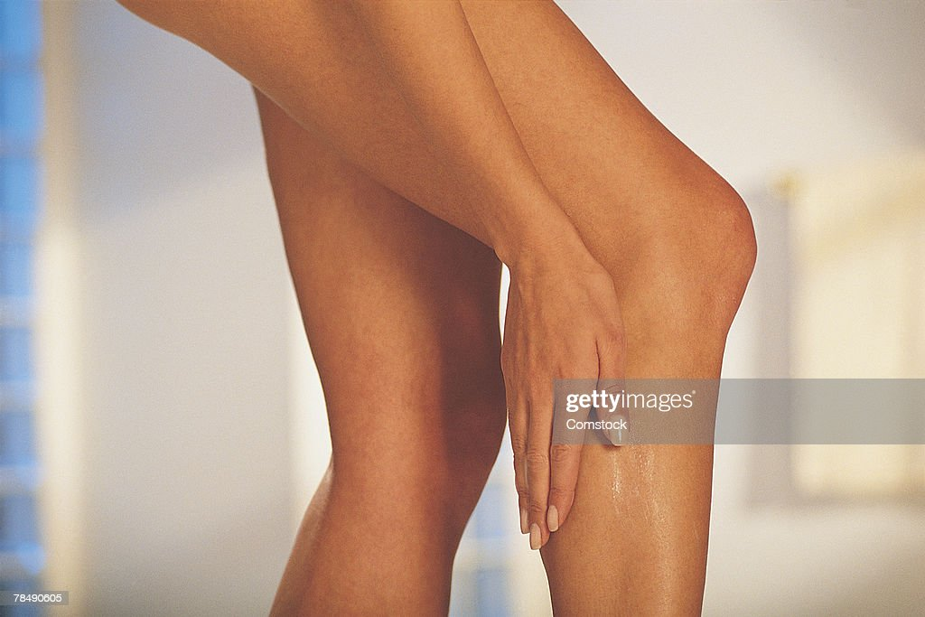 Woman caressing her legs