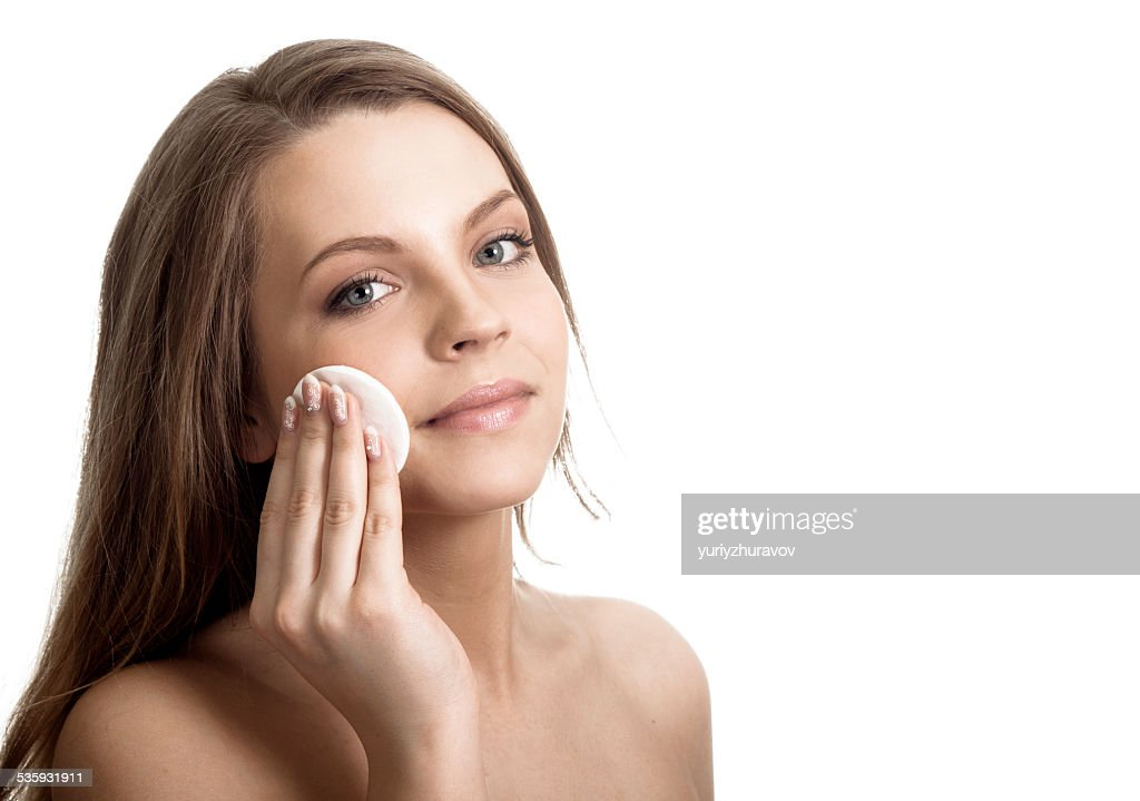 Woman caring about her fresh healthy skin of face : Stock Photo