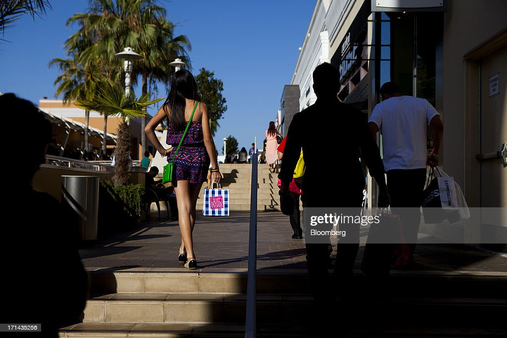 A woman carries a Bath & Body Works shopping bag at the Fashion Valley Mall in San Diego, California, U.S., on Saturday, June 22, 2013. The Bureau of Economic Analysis is schedule to release personal consumption figures on June 26. Photographer: Sam Hodgson/Bloomberg via Getty Images