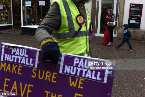 A woman carries a campaign sign in favor of the UKIP part in Stoke on Trent United Kingdom on February 22 2016 The city suffers from high...