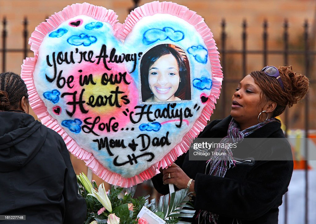 A woman carries a heart-shaped memorial into the Greater Harvest Baptist Church for the funeral of 15-year-old Hadiya Pendleton on Saturday, February 9, 2013, in Chicago, Illinois. Pendleton, who performed at President Obama's inauguration, was killed January 29 when a gunman fired on a group of students.