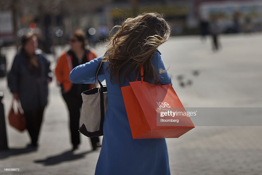 A woman carries a Joe Fresh shopping bag while walking through Union Square in New York, U.S., on Thursday, April 4, 2013. Confidence among U.S. consumers stabilized last week, stemming a pullback in sentiment that had threatened to check recent gains in spending. Photographer: Victor J. Blue/Bloomberg via Getty Images