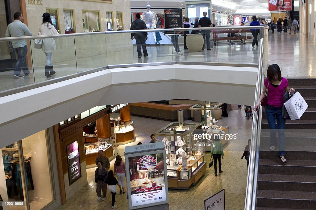 A woman carries a Lord & Taylor LLC shopping bag while descending stairs at the Fair Oaks Mall in Fairfax, Virginia, U.S., on Monday, Nov. 12. 2012. Sales at U.S. retailers probably fell in October for the first time in four months economists said before a report on Nov. 14. Photographer: Andrew Harrer/Bloomberg via Getty Images