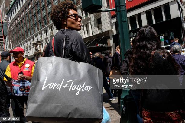 A woman carries a Lord Taylor shopping bag in the Herald Square neighborhood in New York City May 12 2017 The US Commerce Department says retail...