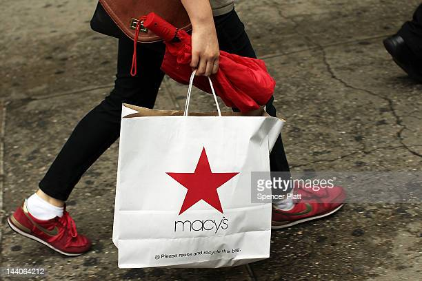 A woman carries a Macy's shopping bag in front of the flagship store on May 9 2012 in New York City Beating Wall Street's expectations Macy's Inc...