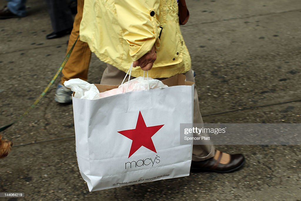 A woman carries a Macy's shopping bag in front of the flagship store on May 9, 2012 in New York City. Beating Wall Street's expectations, Macy's Inc. reported a 38 percent increase in its first-quarter profit for the department store.