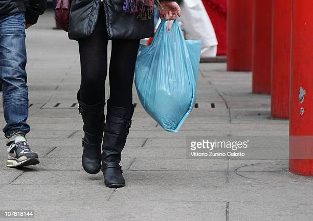 A woman carries a plastic bag on December 30 2010 in Milan Italy Italy who currently use approximately 20 billion plastic bags per year is banning...