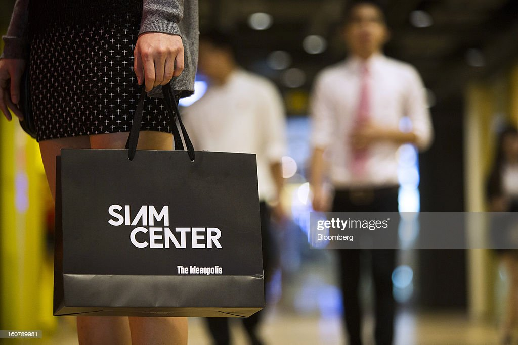 A woman carries a shopping bag inside the Siam Center shopping mall in Bangkok, Thailand, on Tuesday, Feb. 5, 2013. Thai inflation may average 2.8 percent this year, the Bank of Thailand said. Photographer: Brent Lewin/Bloomberg via Getty Images
