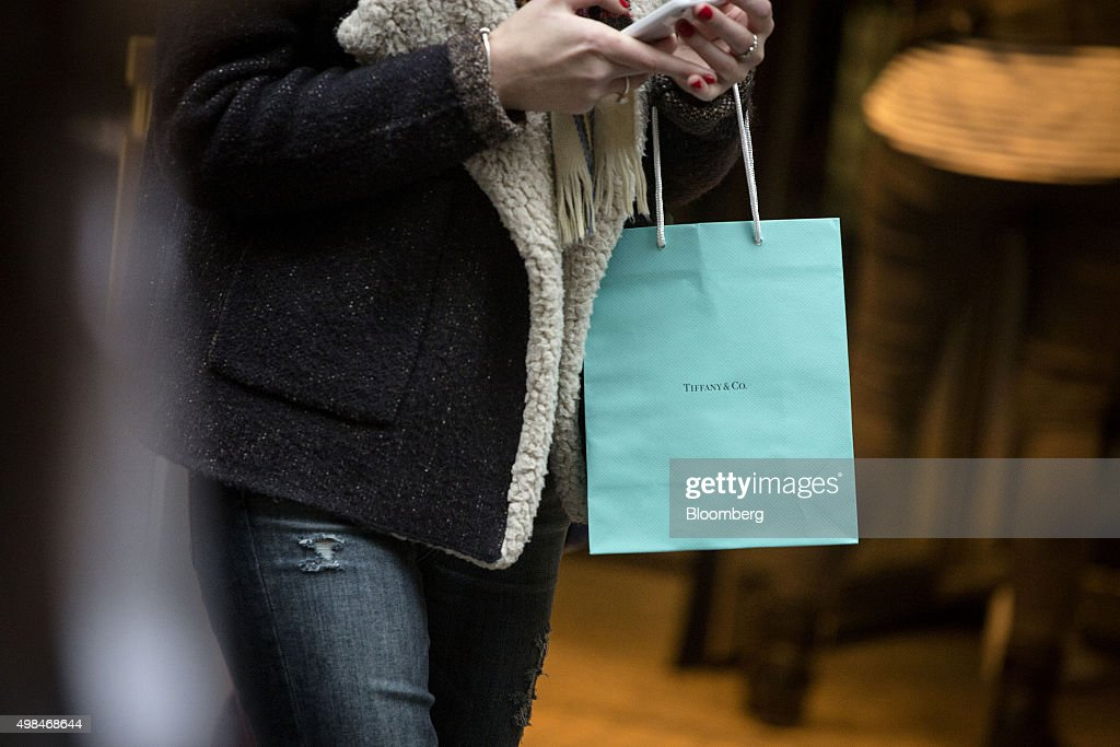 A woman carries a Tiffany Co shopping bag in New York US on Sunday Nov 22 2015 Tiffany Co is scheduled to report earnings figures on November 24...