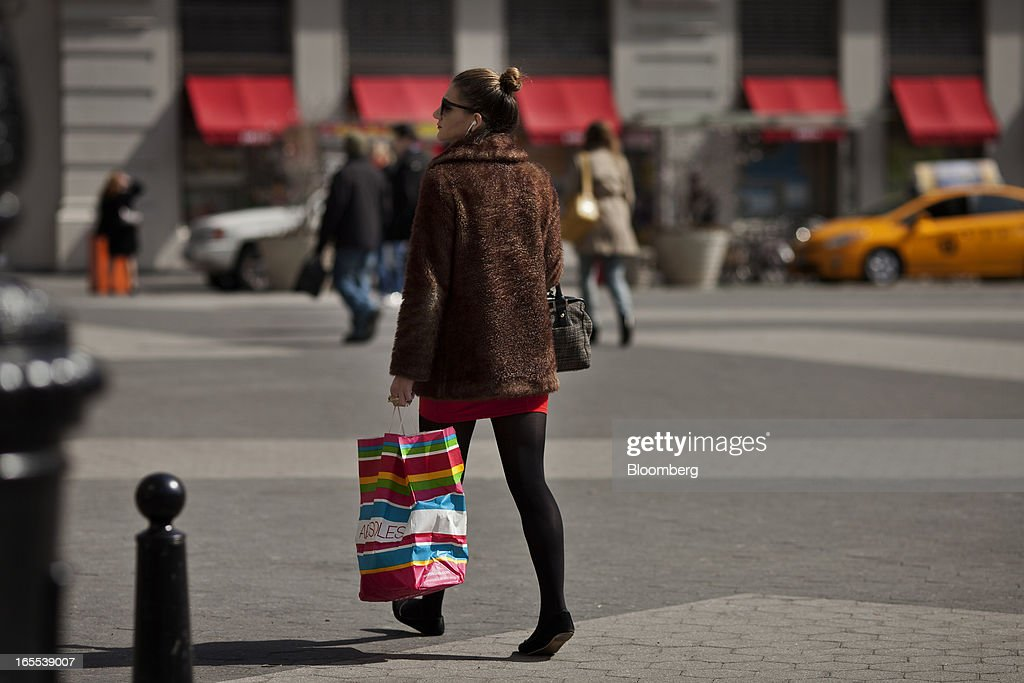 A woman carries an Aerosoles shopping bag while walking through Union Square in New York, U.S., on Thursday, April 4, 2013. Confidence among U.S. consumers stabilized last week, stemming a pullback in sentiment that had threatened to check recent gains in spending. Photographer: Victor J. Blue/Bloomberg via Getty Images