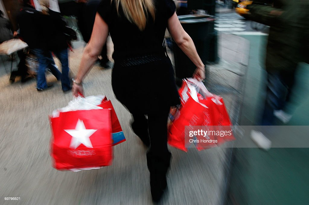 A woman carries bags from Macy's department store in midtown Manhatann December 3, 2009 in New York City. Retail sales declined 0.3 percent, with Macy's dopping 6.1 percent, in November, leading some analysts to fear that the holiday season will not live up to expectations.