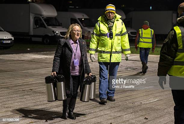 A woman carries flasks of tea and coffee into the Richmond Park byelection count at Richmond Upon Thames College on December 1 2016 in London England...