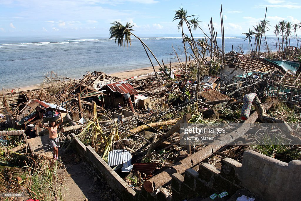 A woman carries items from a heavily damaged village after Typhoon Bopha, on December 8, 2012 in the town of Boston, Davao Oriental province, Philippines. More than 500 people have been killed and scores of others remain missing after Typhoon Bopha, the strongest storm to hit the Philippines this year, pounded the region. The United Nations Office for the Coordination of Humanitarian Affairs reported that about 5.3 million people are affected and 533 are missing.