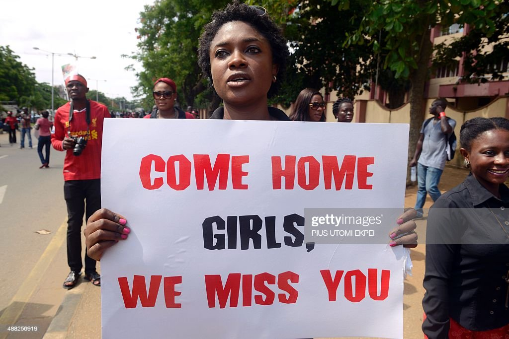 A woman carries placard to press for the release of missing Chibok school girls during a rally by civil society in Lagos on May 5 2014 Boko Haram on...
