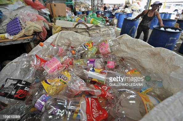 A woman carries recyclable garbage at La Alqueria Recycling Center in Bogota Colombia on January 17 2013 Some 60 recyclers classify 10 tons daily of...