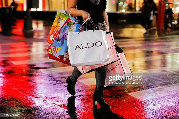 A woman carries retail shopping bags during Black Friday events on November 25 2016 in New York City The day after Thanksgiving called Black Friday...