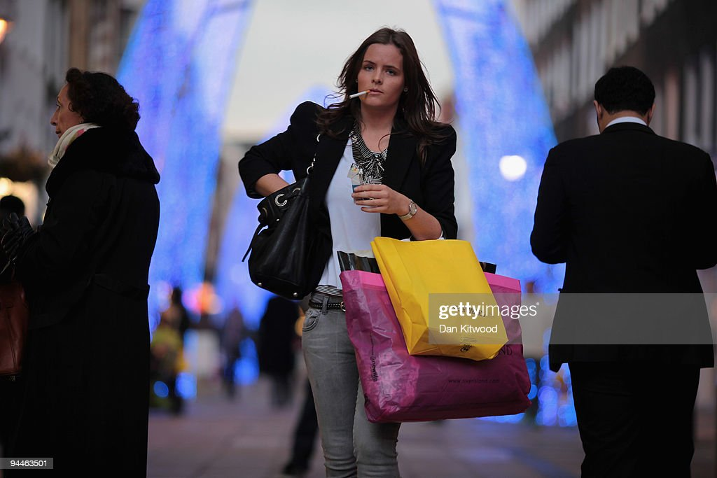 A woman carries shopping bags off New Bond Street on December 14, 2009 in London, England. High street stores are expecting a bumper Christmas this year despite the economic dowturn, with shoppers spending around GBP £120 million in the past two days alone.