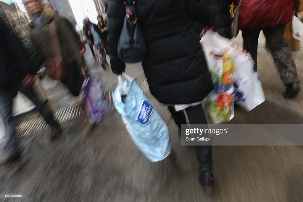A woman carries shopping bags on a shopping street in Steglitz district on December 17, 2012 in Berlin, Germany. Retailers are hoping for a strong Christmas season in Germany, one of the few countries whose economy has so far weathered the current Eurozone debt crisis relatively well.