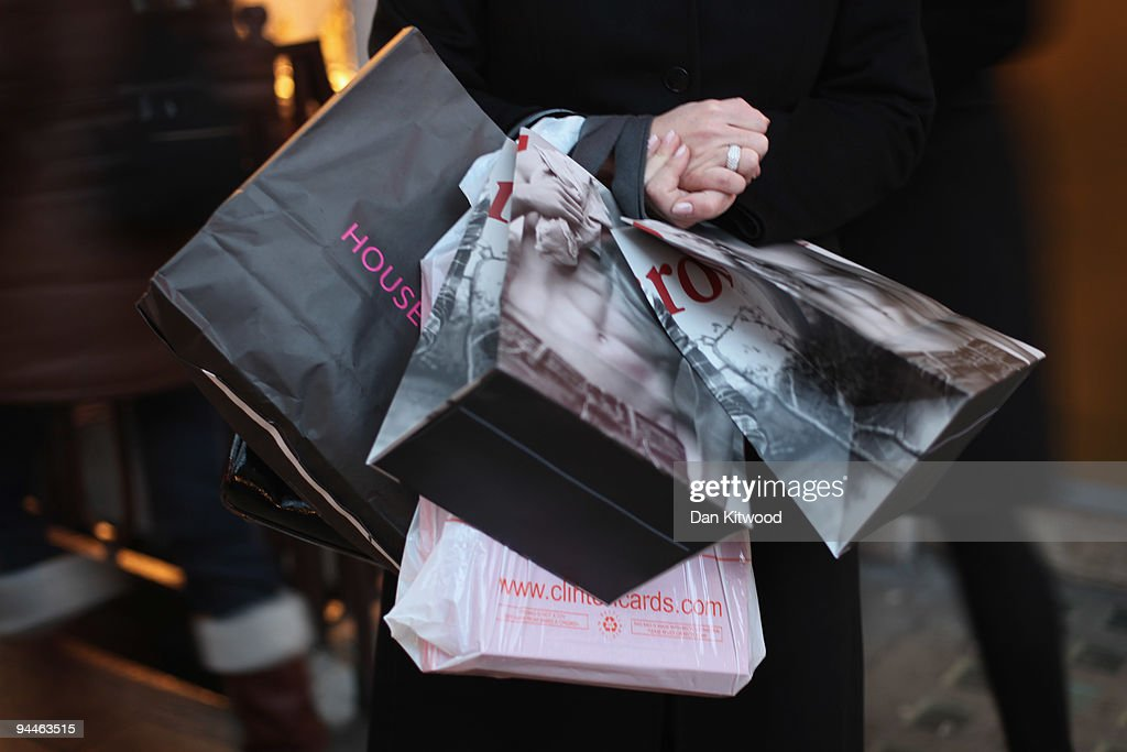 A woman carries shopping bags on New Bond Street on December 14, 2009 in London, England. High street stores are expecting a bumper Christmas this year despite the economic dowturn, with shoppers spending around GBP £120 million in the past two days alone.