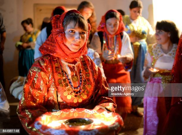 A woman carries the henna tattoo tray during a Macedonian indigenous Juruk tribe wedding in Pochival Village near Stip Macedonia on September 9 2017...