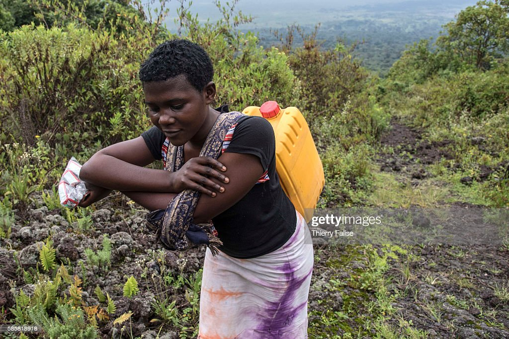 A woman carries water to the top of Mount Nyiragongo The Nyiragongo is an active stratovolcano with an elevation of 3470 metres in the Virunga...