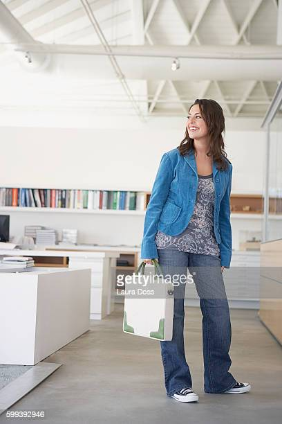 Woman carrying a briefcase