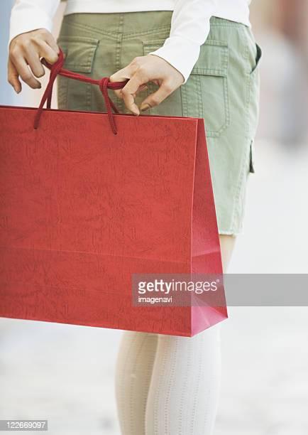 A woman carrying a shopping bag